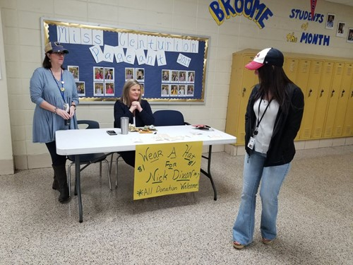 Teacher Jana Calvert heads the donation table