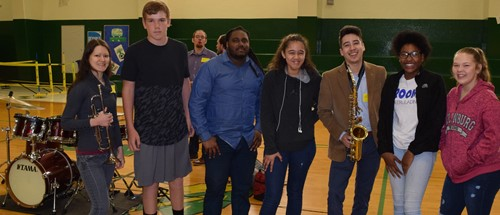 Student with jazz members after performance.