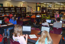 Students working on computers in media center.