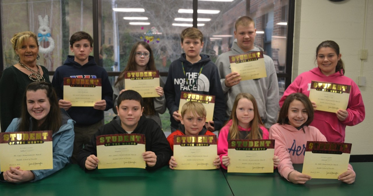 Students holding awards.