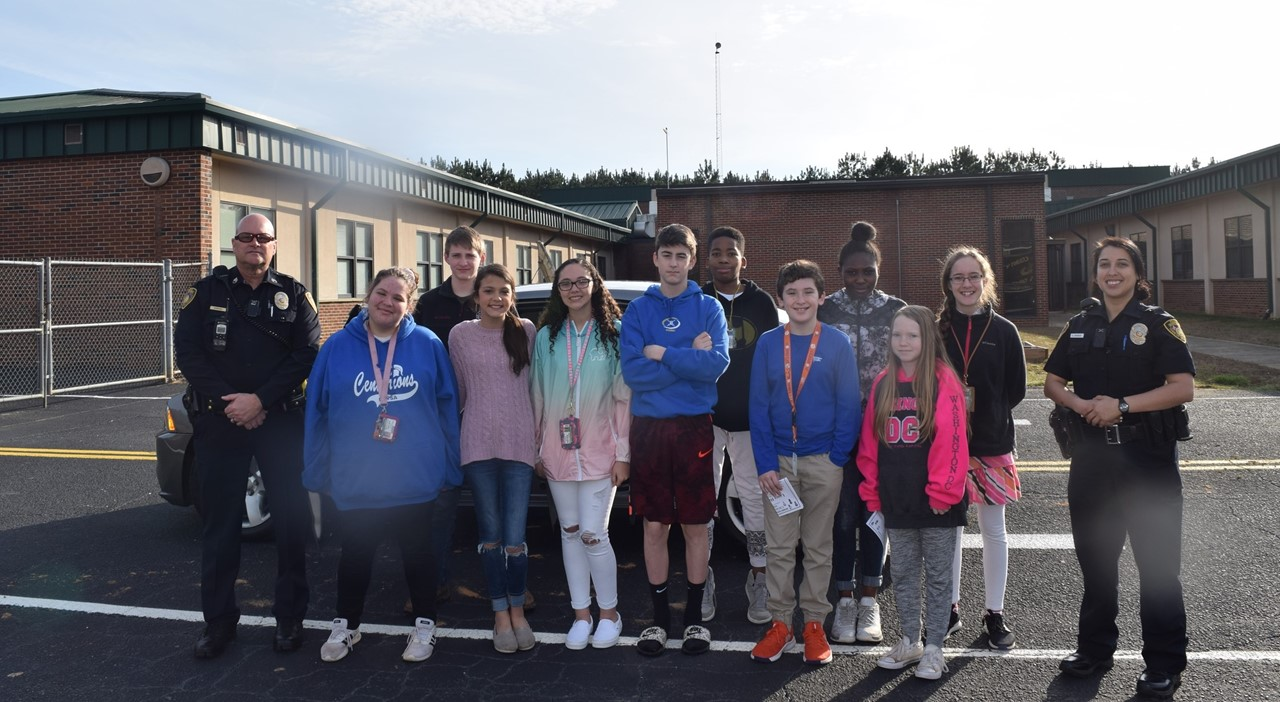 Officer and students  outside of school.