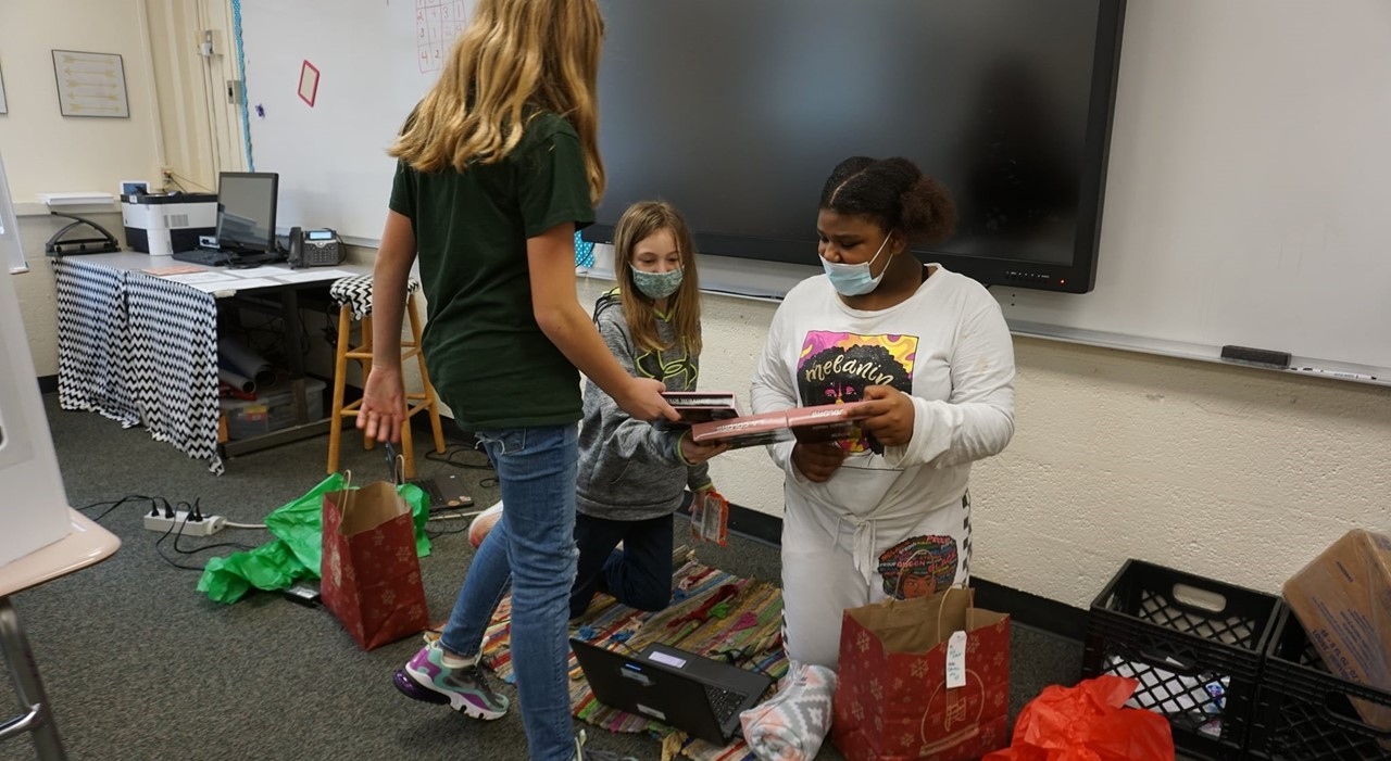 Students opening gifts.