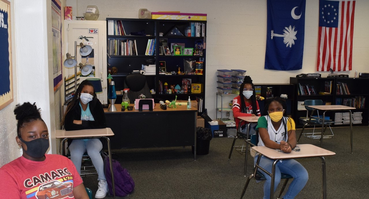 Students are pictured with mask , on first day back to school.