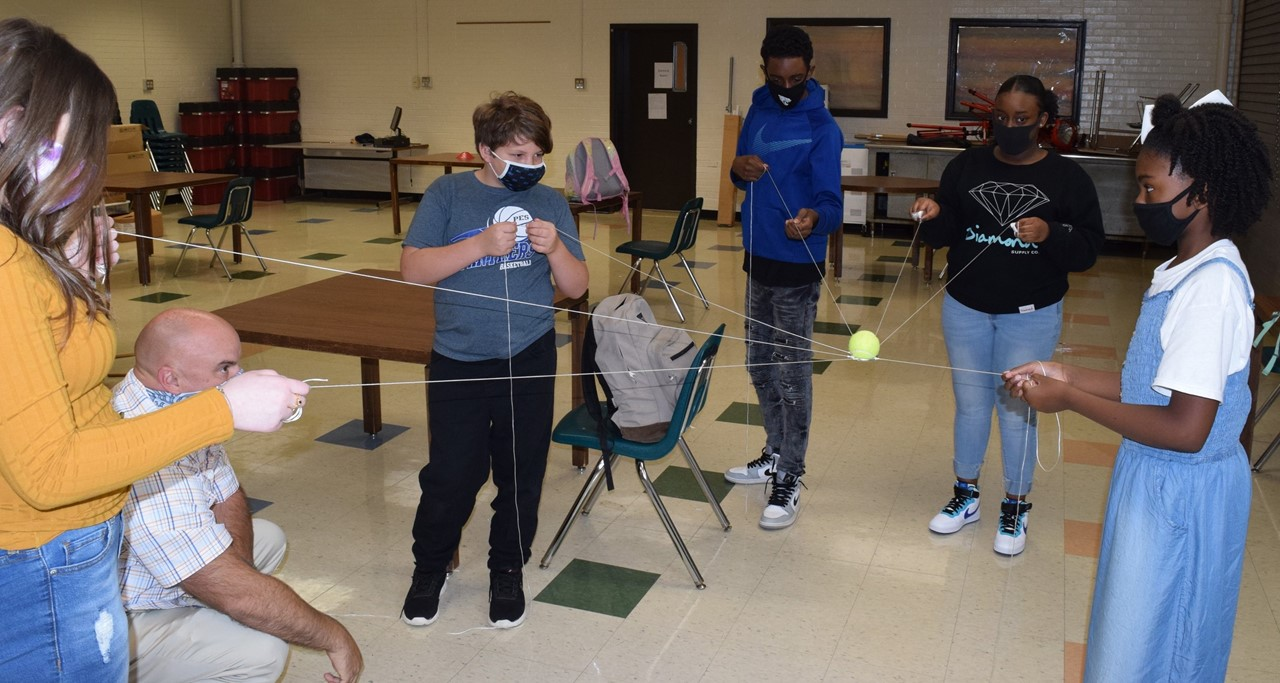 Students with string exercise,with teacher.