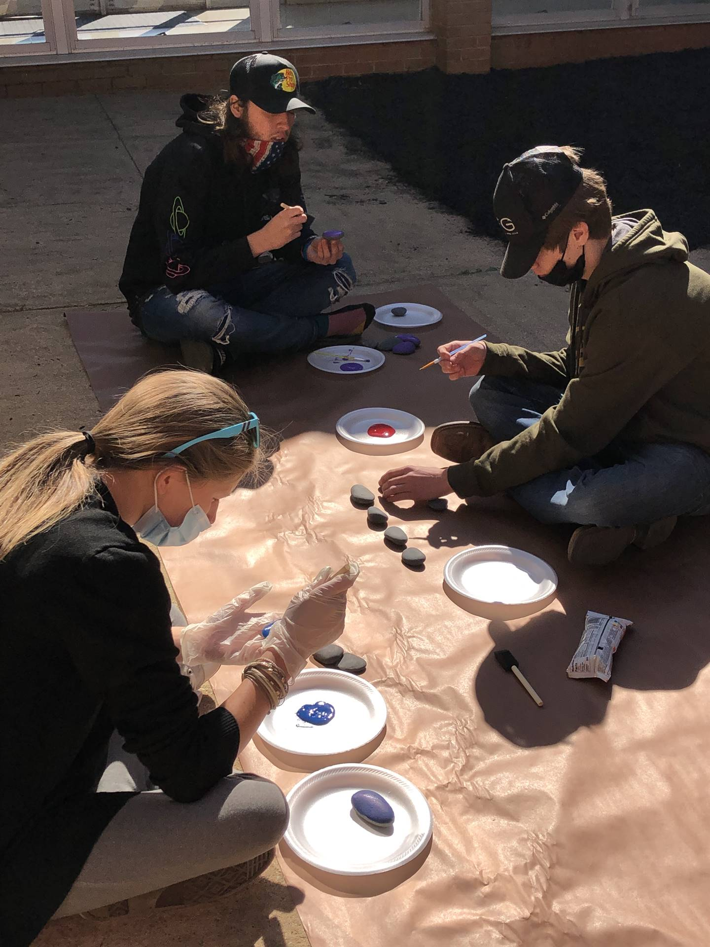 Group of Students Painting Rocks